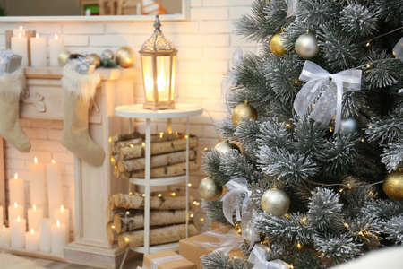 Beautiful Christmas tree decorated with shiny balls at home