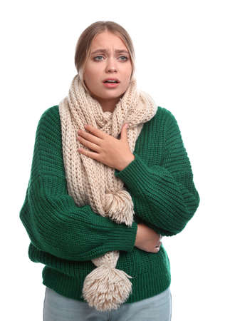 Young woman suffering from cold on white background