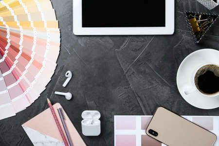 Flat lay composition with digital devices and color palette on grey background, space for text. Graphic designers workplace