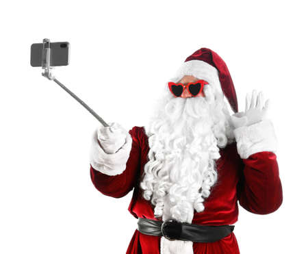 Authentic Santa Claus taking selfie on white background