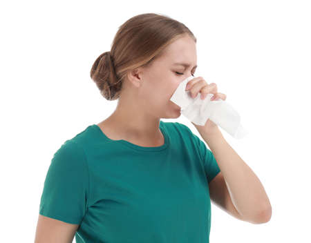 Young woman suffering from allergy on white background