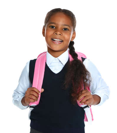 Happy African-American girl in school uniform on white background Stock Photo