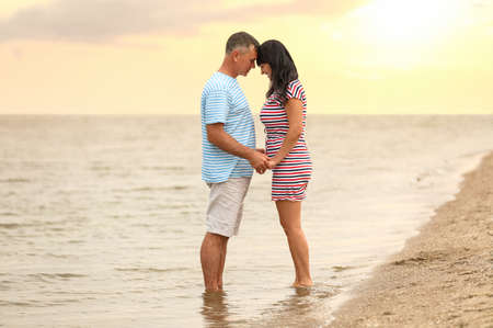 Happy mature couple spending time together on sea beach
