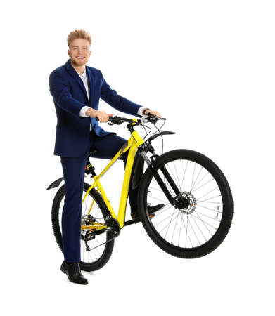 Young businessman riding bicycle on white background Stok Fotoğraf