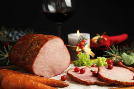Delicious ham served on wooden board. Christmas dinner Stock fotó