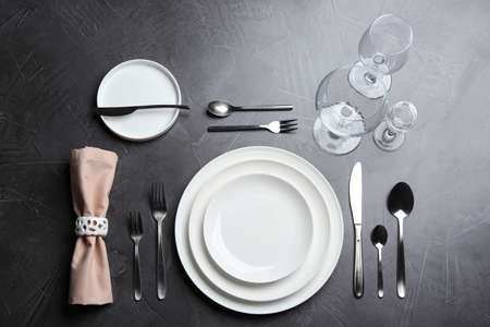 Elegant table setting on grey background, flat lay Imagens
