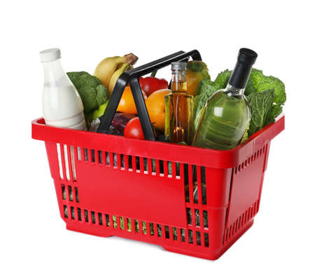 Shopping basket with grocery products on white background Foto de archivo