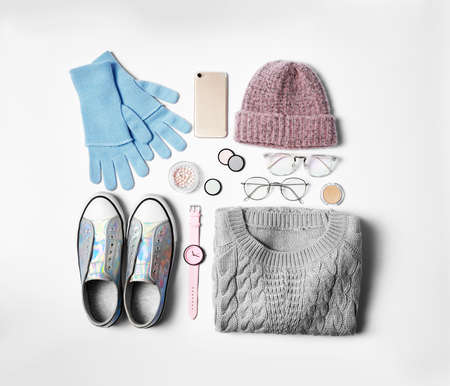 Stylish female autumn outfit and accessories on white background, flat lay. Trendy warm clothes