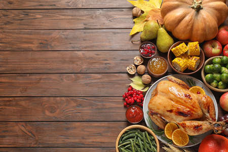 Flat lay composition with turkey on wooden background, space for text. Happy Thanksgiving day Stock Photo