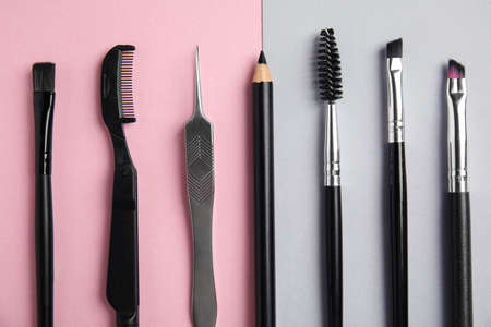 Set of professional eyebrow tools on color background, flat lay Stock Photo