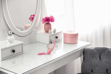 White dressing table near window in light room