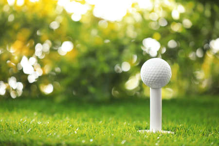 Golf ball on tee at green course