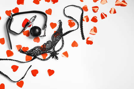 Composition with accessories for role play and red hearts on white background, top view