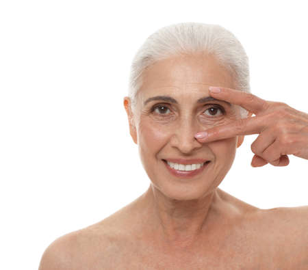 Portrait of beautiful mature woman on white background