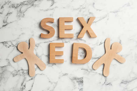 Phrase SEX ED made of wooden letters on marble background, flat lay Stock Photo