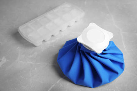 Composition with ice pack on marble table