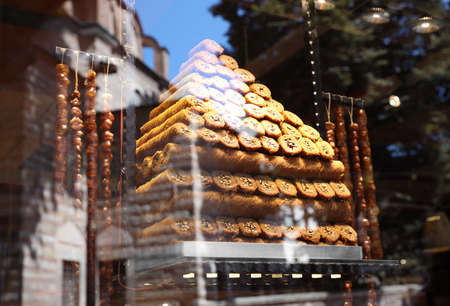 Shop with different sweets, view through window glass