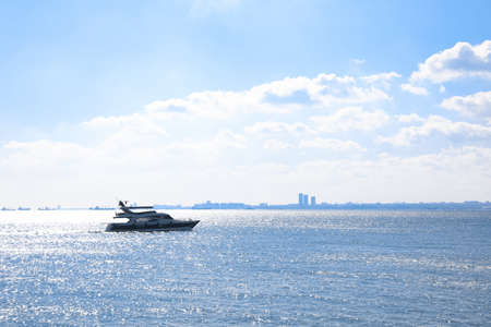 Beautiful sea with motorboat on sunny day