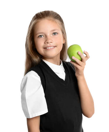 Happy girl with apple on white background. Healthy food for school lunch 免版税图像