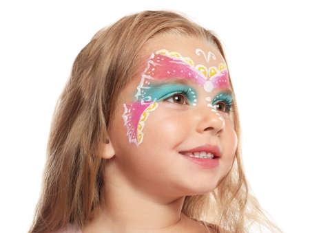Cute little girl with face painting on white background