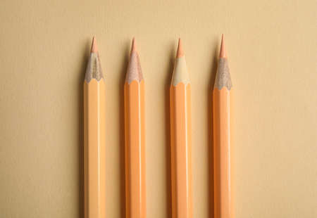 Flat lay composition with color pencils on beige background