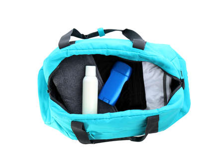 Sport bag with deodorants and clothes on white background, top view Stockfoto