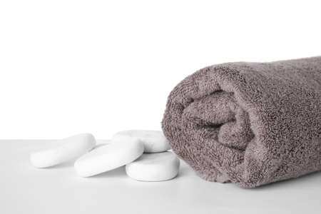 Soft towel and marble spa stones isolated on white Фото со стока