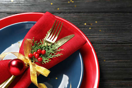 Beautiful Christmas table setting on wooden background, closeup