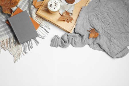 Flat lay composition with soft knitted sweater on white background Archivio Fotografico