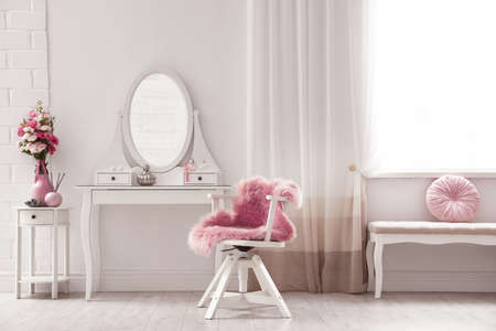 Stylish room interior with white dressing table