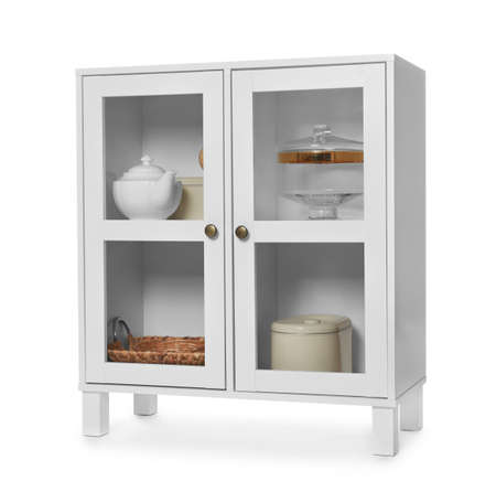 Wooden cabinet with kitchenware on white background