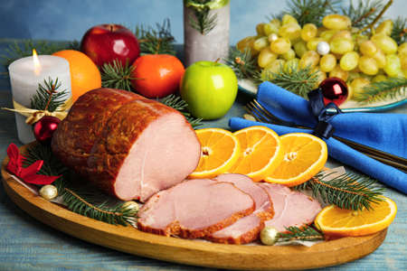 Delicious ham served on blue wooden table. Christmas dinner