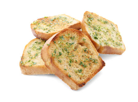 Slices of toasted bread with garlic and herbs on white background Stock fotó