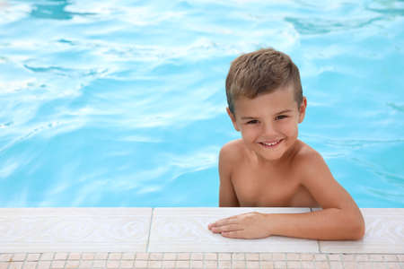 Cute little boy in outdoor swimming pool Stock Photo