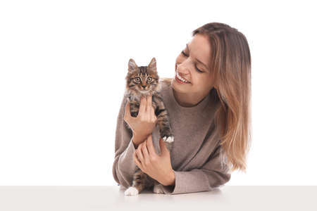 Young woman with cat on white background. Owner and pet