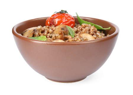 Delicious buckwheat porridge with mushrooms and tomato on white background