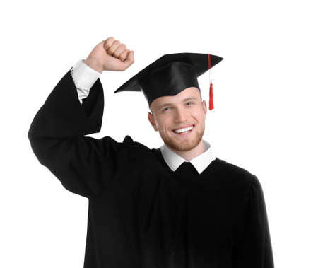 Happy student wearing graduation hat on white background 스톡 콘텐츠