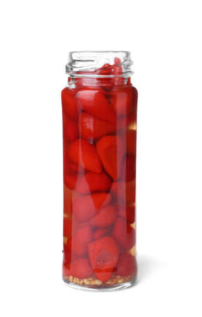 Jar with pickled hot peppers on white background Banco de Imagens