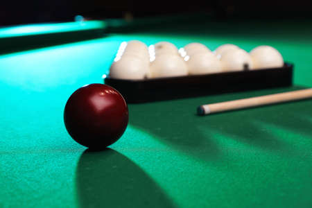 Billiard balls, triangle rack and cue on table. Space for text Stock Photo