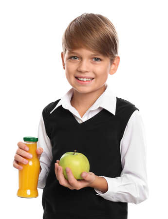 Happy boy holding bottle of juice and apple on white background. Healthy food for school lunch