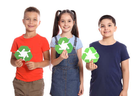 Children with recycling symbols on white background