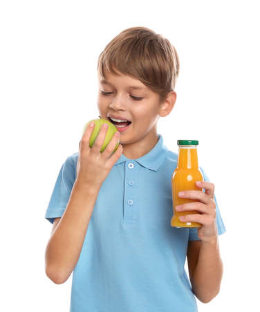 Little boy with bottle of juice and apple on white background. Healthy food for school lunch