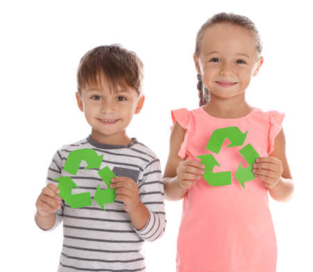 Little children with recycling symbols on white background