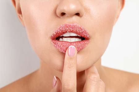 Young woman with sugar lips on white background, closeup Standard-Bild - 131489251
