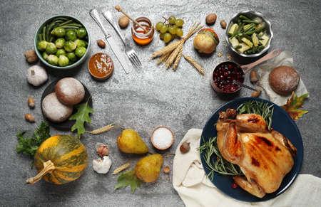 Frame made of delicious turkey, autumn vegetables and fruits on grey background, flat lay with space for text. Happy Thanksgiving day Stock fotó