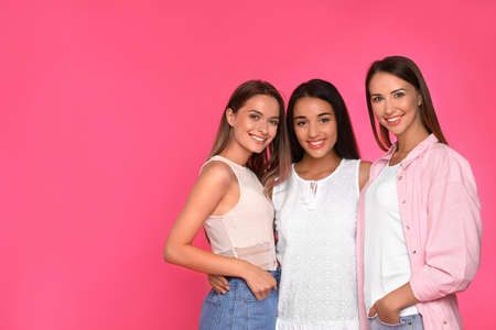 Happy women on pink background, space for text. Girl power concept