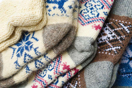 Different knitted woolen socks as background, closeup Stockfoto
