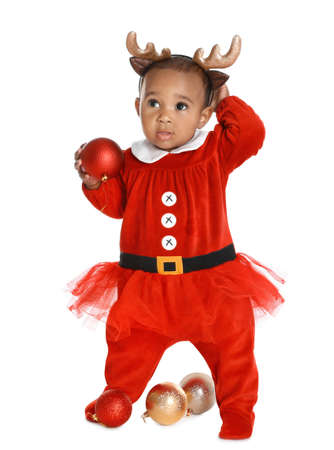 Little African-American baby wearing festive Christmas costume on white background