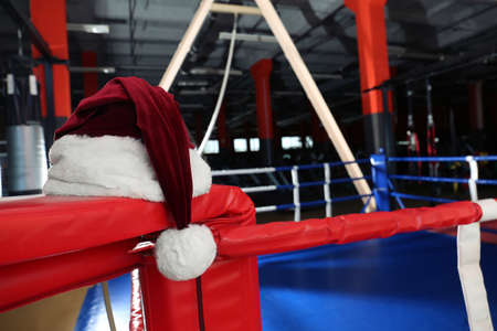 Santa hat in corner of boxing ring. Space for text