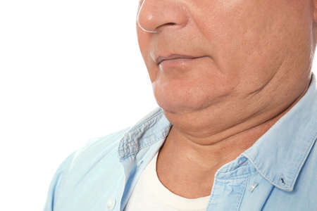 Mature man with double chin on white background, closeup